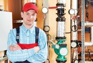 maintenance repairman engineer of heating system equipment in a boiler house
